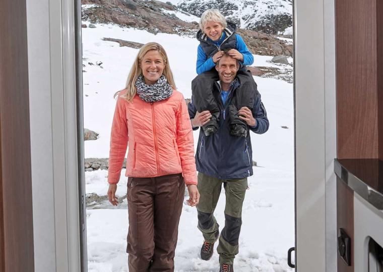 Family entering a caravan at the side door