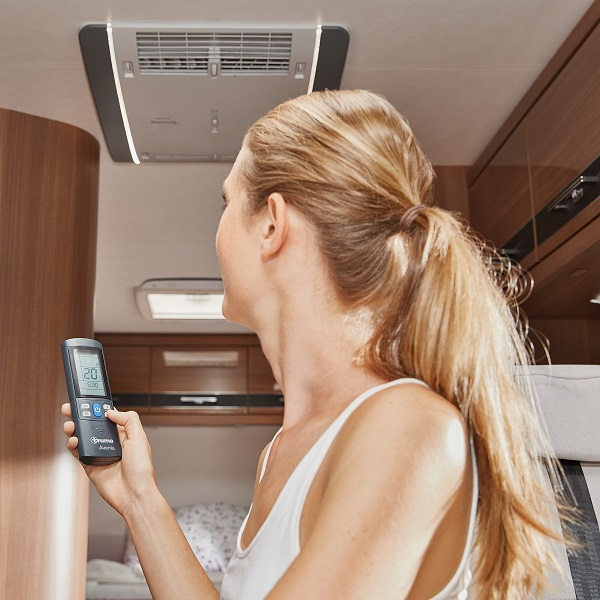 Woman with Aventa remote control inside caravan