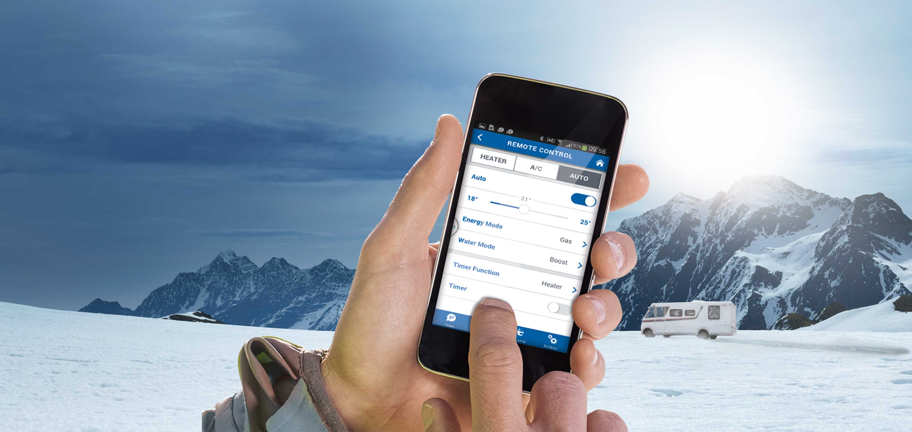 Truma App on a smartphone in front of winter landscape